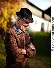 Old Romanian farmer - Happy Romanian senior farmer near a...