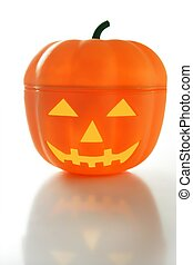 Plastic halloween pumpkin, white background with reflex over...