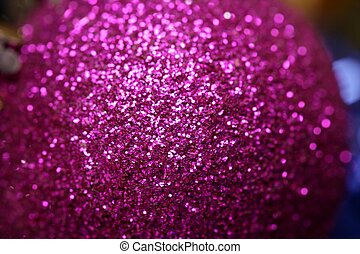 Christmas decoration, purple glitter ball, red background -...