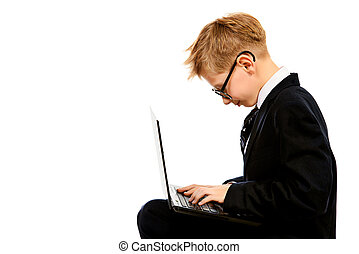 programmer - Portrait of a smart boy in a suit and glasses...