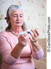 Woman testing for high blood sugar.