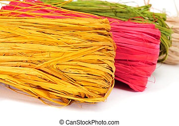 natural raffia of different colors - some skeins of natural...