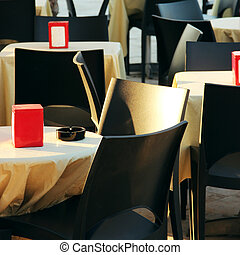 caf - black chairs and yellow tables of caf