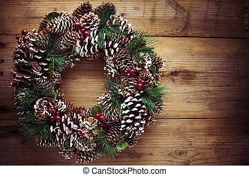 Christmas wreath on a rustic wooden door - Christmas wreath...