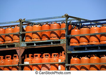 Botellas, bombonas de gas butano color Naranja. Orange Gas...