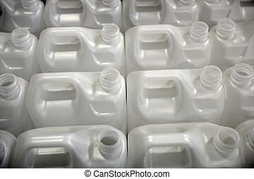 Bottles in factory rows, white plastic environment recycle...