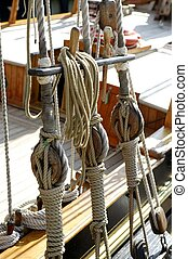 Sailboat wooden marine rigs and ropes. Nautical traditional...
