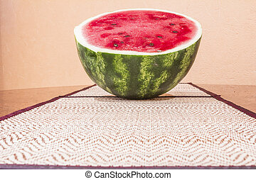 isolated object. - Watermelon on straw napkin with a blurred...