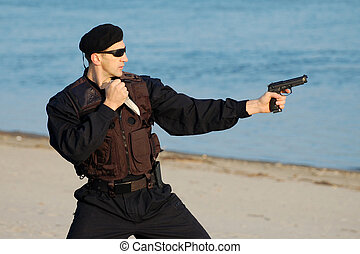 security man - The security man is with gun and knife.