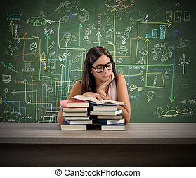 Interested teacher - A young teacher concentrated reading a...