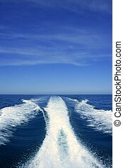 Boat white wake on the blue ocean sea