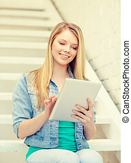 smiling female student with tablet pc computer - education...