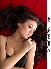 Image of beautiful woman with curly dark hair - Studio shot...