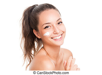Clean beauty - Portrait of gorgeous brunette using body milk...
