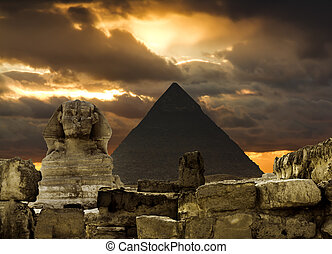 The Sphinx and the pyramid of Cheops in Giza Egipt at sunset...