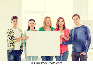students at school holding white blank board - education,...