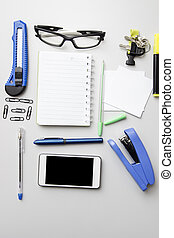 Different business objects on wooden desk.