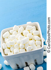 Marshmallows - Small round white marshmallows on blue...