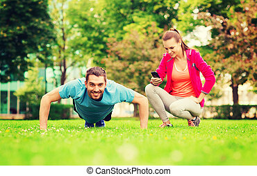 smiling man doing exercise outdoors - fitness, sport,...