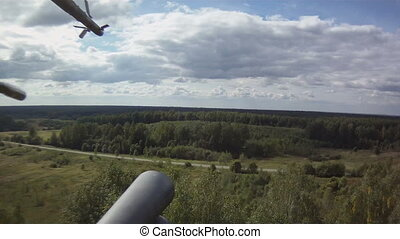 View on meadow from helicopter - View from window of...