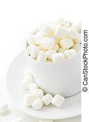 Marshmallows - Small round white marshmallows on a white...