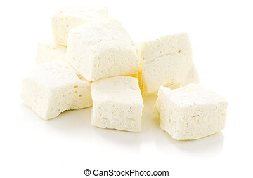 Marshmallows - Homemade white vanilla bean marshmallows on a...