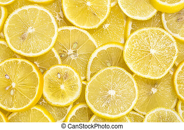 background of sliced ripe lemons