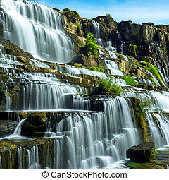 Tropical rainforest landscape with flowing Pongour waterfall...
