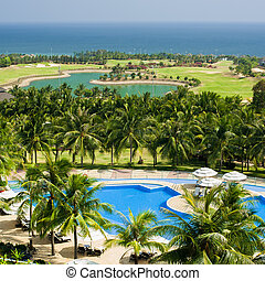 Tropical lhotel with swimming pool and golf field. Mui Ne,...