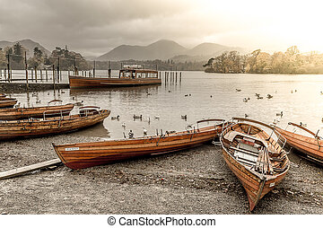 Boats by Lake Derwentwater - Rowing boats resting on...
