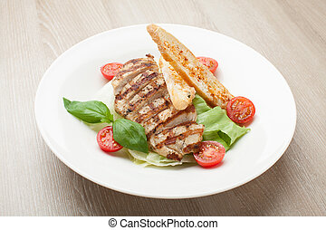 Gourmet caesar salad with grilled meat fillet, cherry tomatoes,