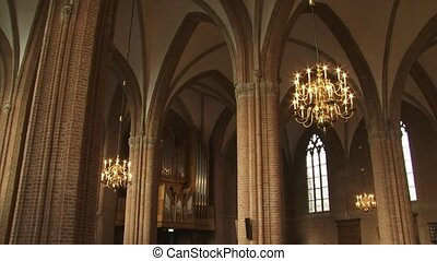 church interior pan gothic arches and chandeliersThe Cunera...