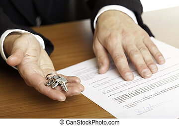 hand over of house keys - one hand of businessman gives...