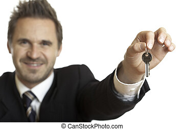 HANDING OVER OF HOUSE KEYS BY BUSINESSMAN
