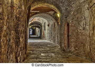 covered alley in Colle di Val dElsa, Tuscany, Italy - the...