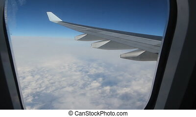 Jet window - Passenger jet in flight Wide angle shot through...