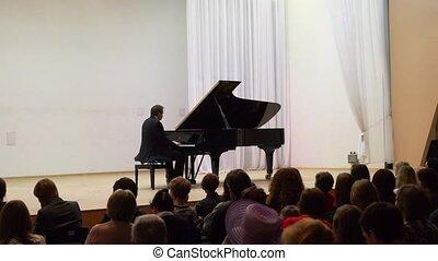 Musician Vladimir Mishchouk performs in Karelia Philarmony -...