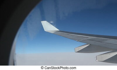 Jet window. Frame detail. - Passenger jet in flight. Wide...