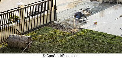 worker tiling floor