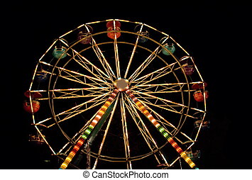 Ferris wheel. Night entertainment.