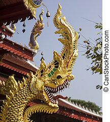 gold naga statue