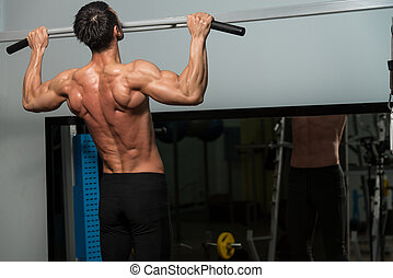 Chin Ups Workout For Back - Male Fitness Athlete Doing Heavy...