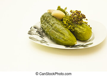 isolated object - plate of pickled cucumbers isolated on...