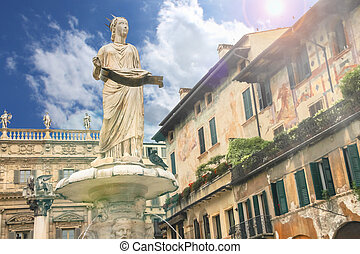 Statue of Madonna on Piazza delle Erbe in Verona,  Italy