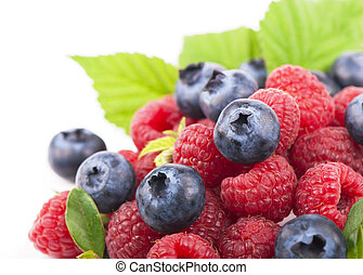 Many blueberries, raspberries. Isolated white