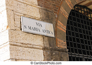 Signboard with name of the street in Verona, Italy