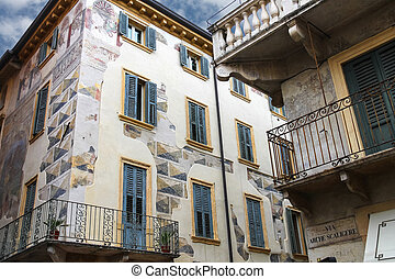 The picturesque house with murals on the street via Arche...