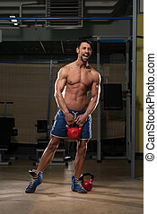 Exercise With Kettle Bell - Athletic Man Workout With Kettle...