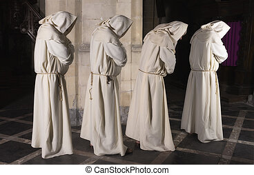 Four monks in a row - Four monks walking in a row along a...