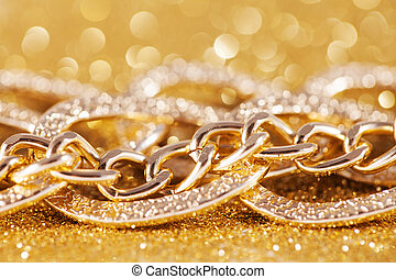 close up of gold chainlet. luxe golden glitter background -...